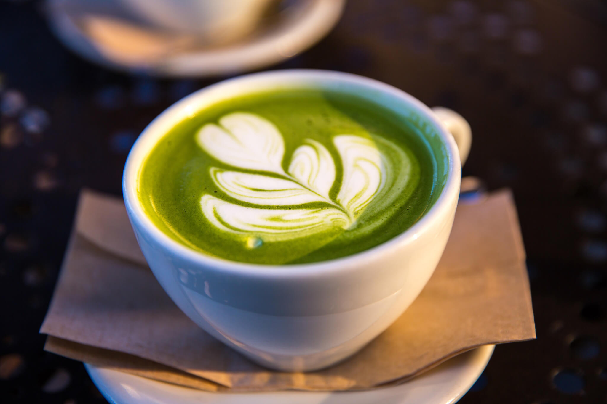 matcha latte in a white mug