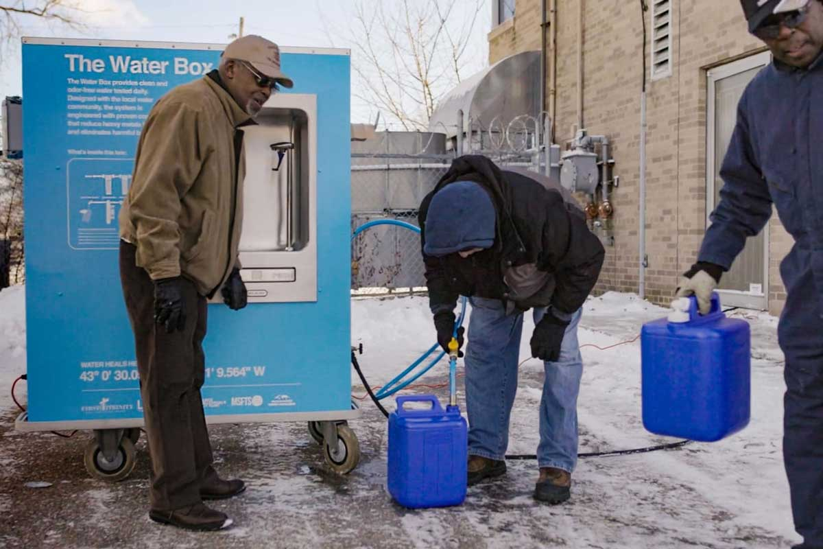 people getting clean water from Water Box supplied by 501CTHREE