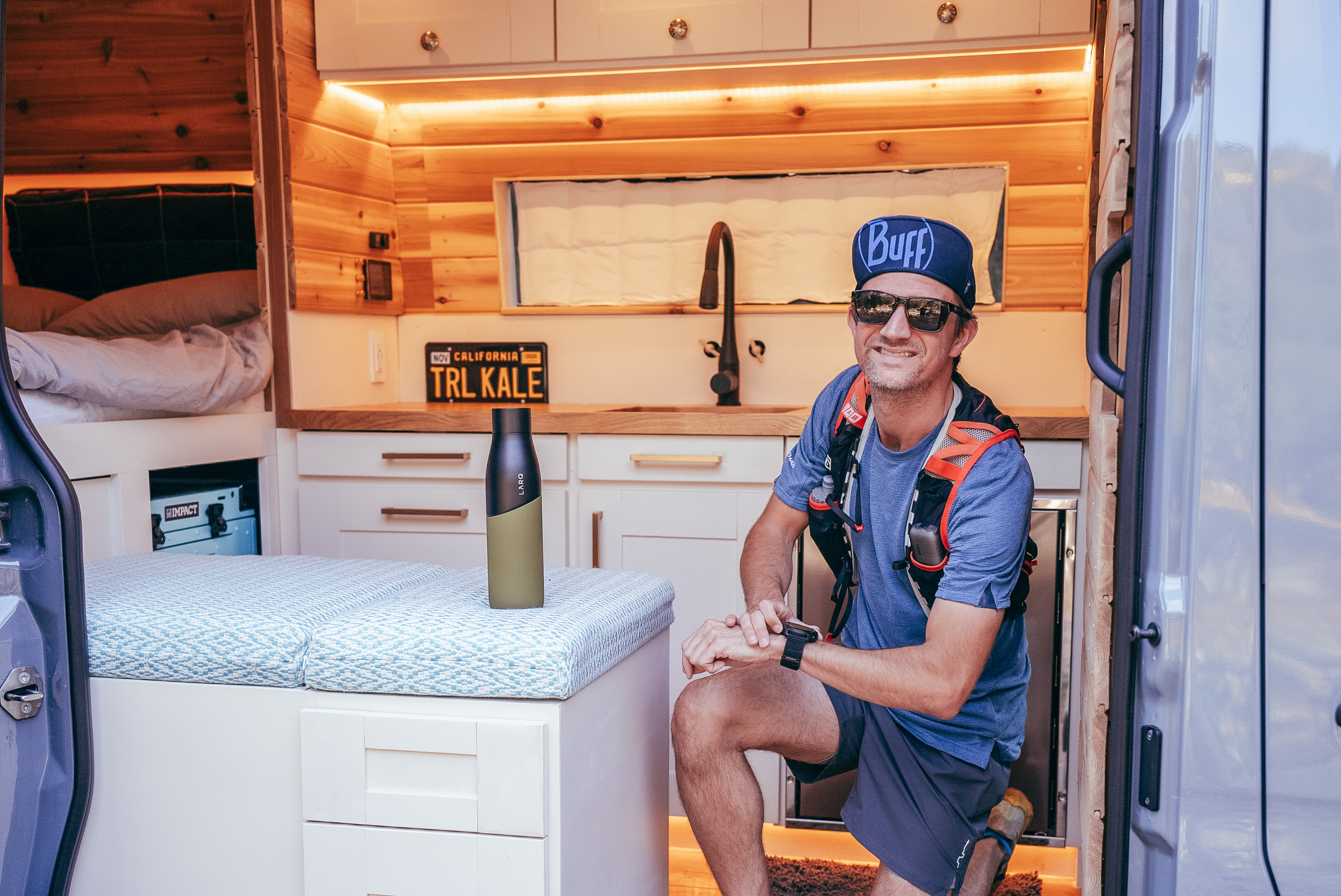 Alastair Dixon of Trail and Kale pictured in his sprinter van with LARQ Bottle Movement in Black/Pine