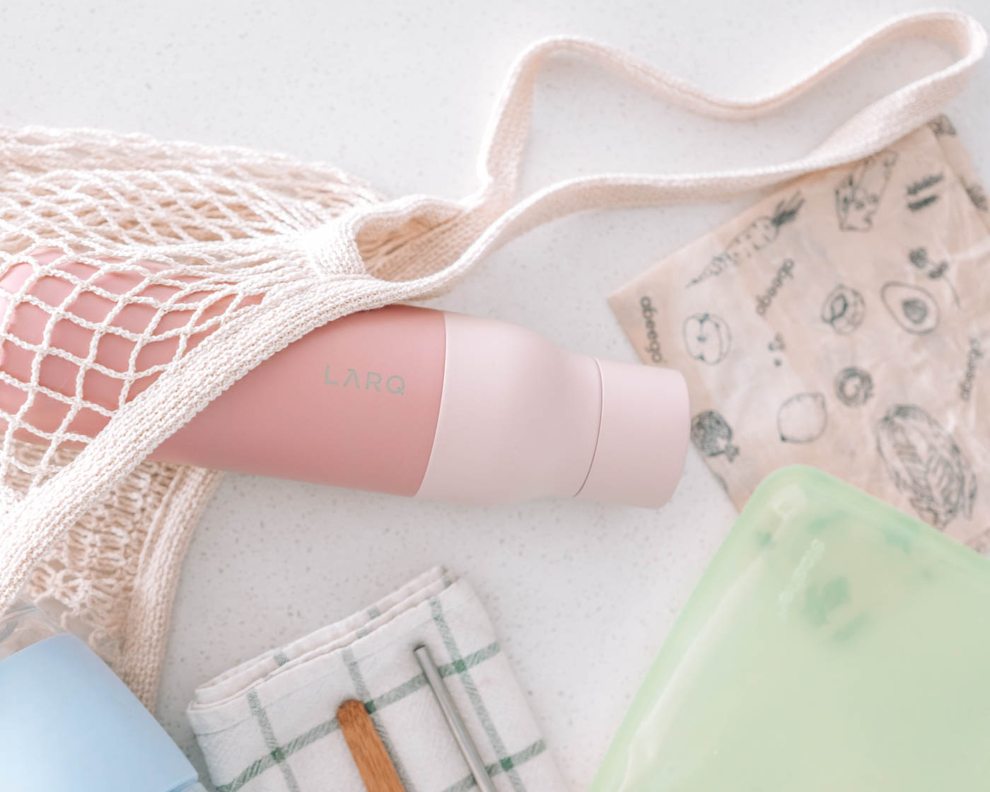 Plastic-Free essentials featuring the LARQ Bottle in Himalayan Pink and other reusable essentials